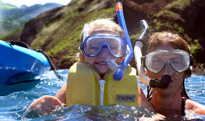 Mom with daughter smiling with snorkels